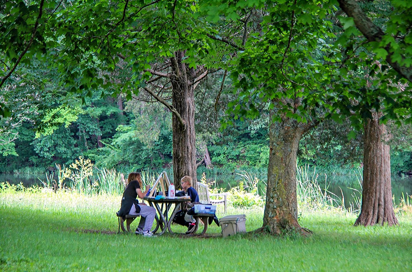 kids painting on canvas out in nature