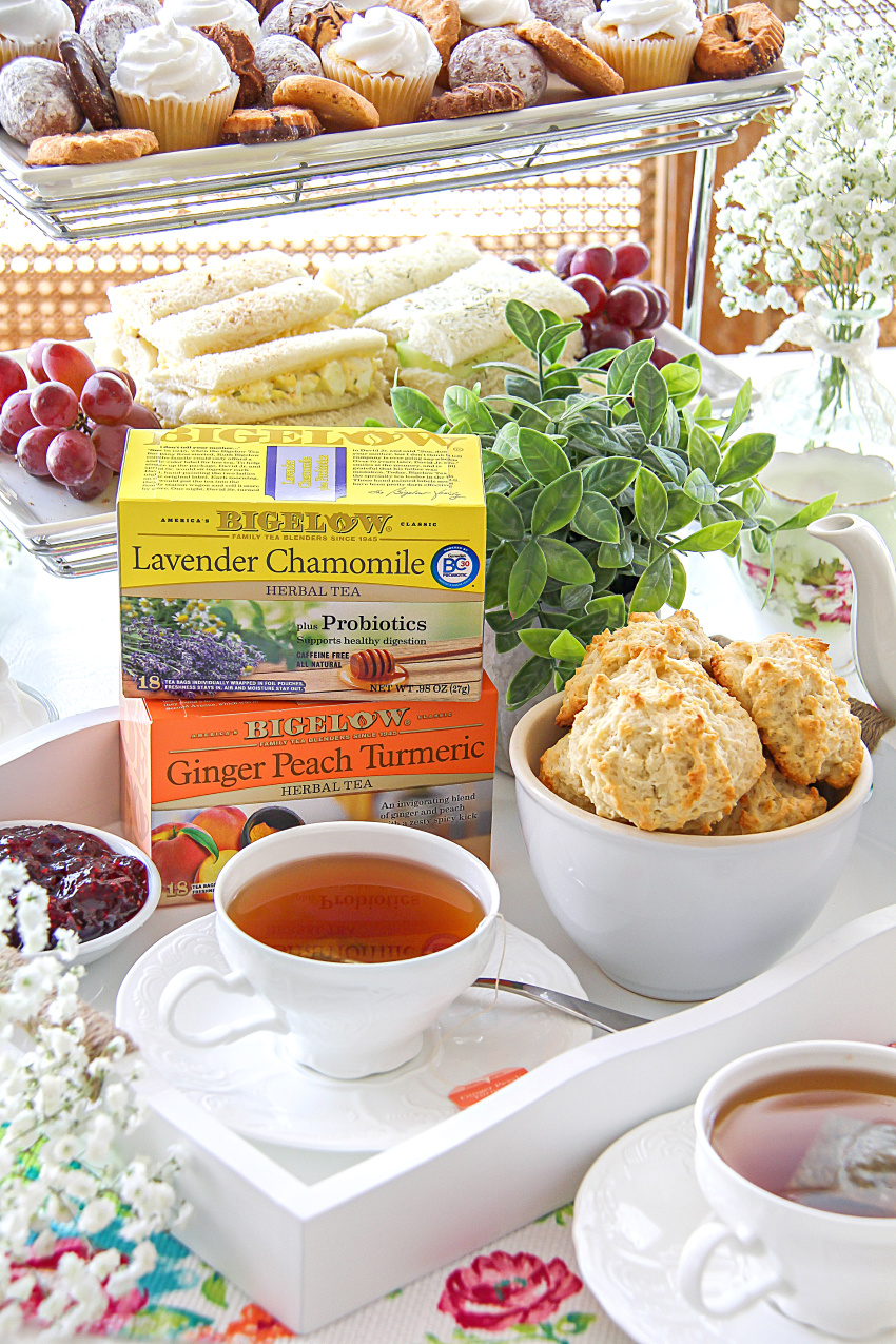 Afternoon tea party table idea with tea, scones, and jam.