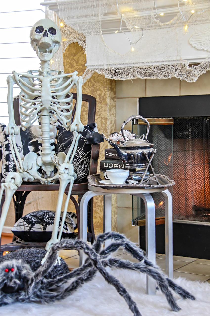A life size skeleton serving brunch for Halloween.
