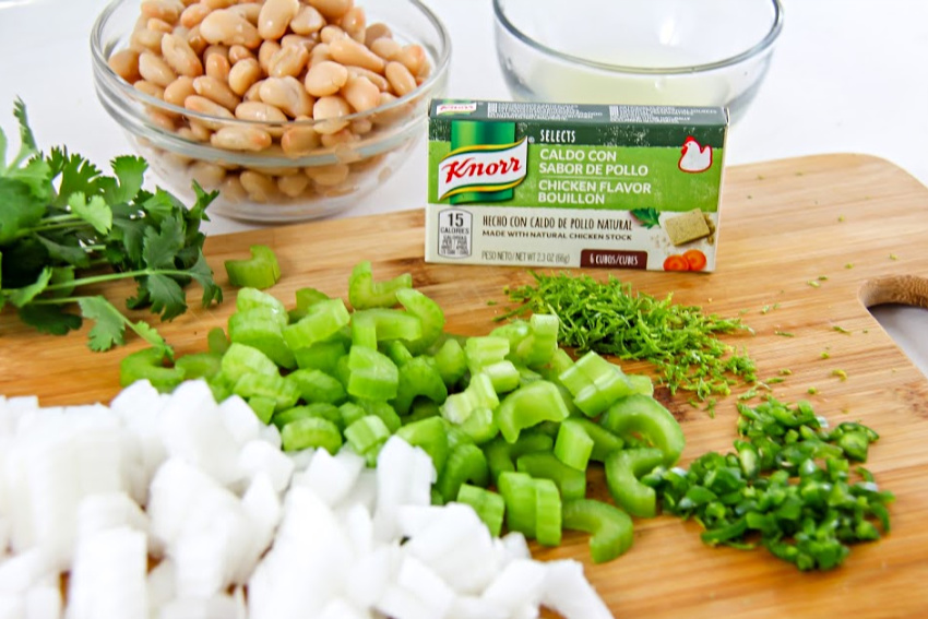 Knorr chicken bouillon with diced celery and onion, fresh herbs and beans