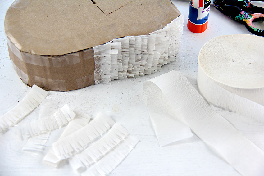 crepe paper fringing cut into strips for a pinata