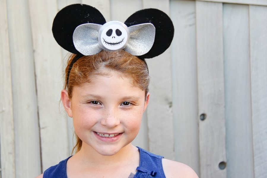 girl wearing jack skellington mickey mouse ear headband in black and silver