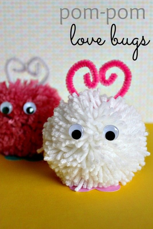 pink and white yarn pom poms turned into love bugs for valentine's day
