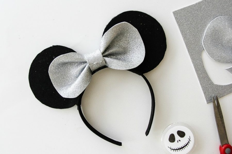 silver and black mickey mouse ear headband with a bow