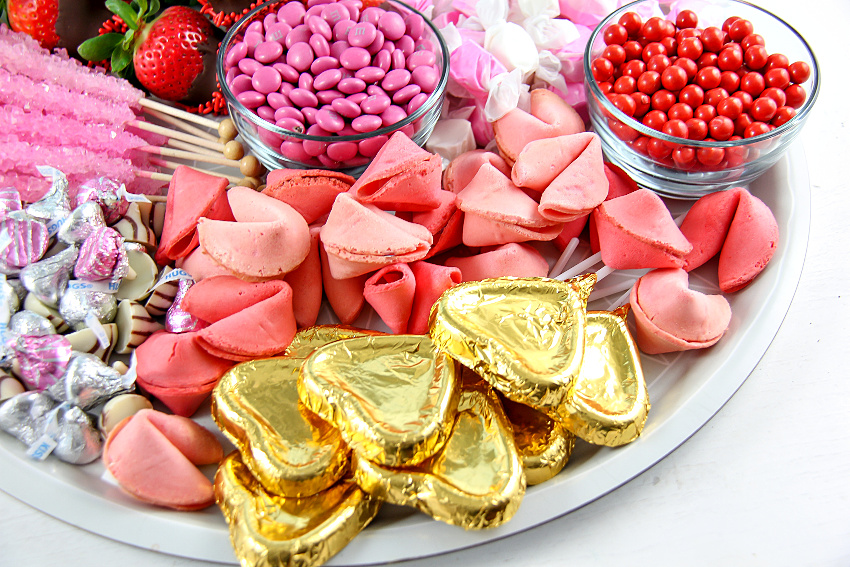 Valentine's Day candy board in pink , gold, and red