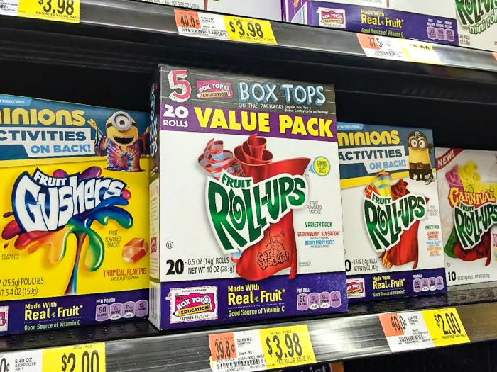 fruit roll-ups and gushers on a store shelf