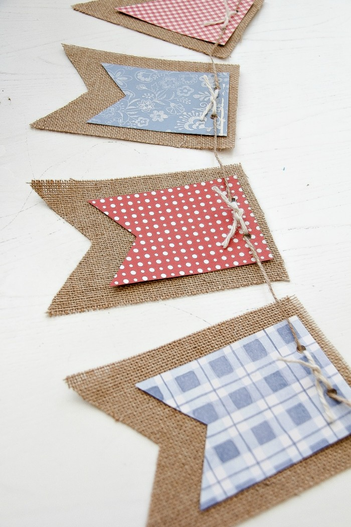 A red, white, and blue banner made with scrapbook paper and burlap for 4th of July.