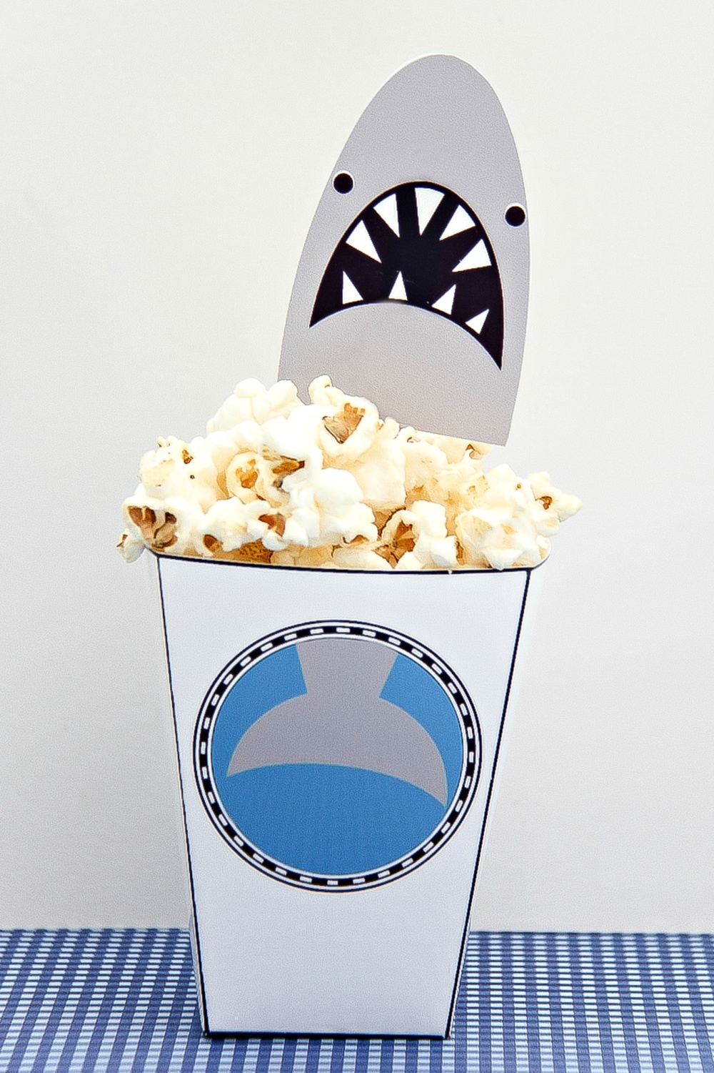 mini popcorn tubs with a shark head sticking out of the top