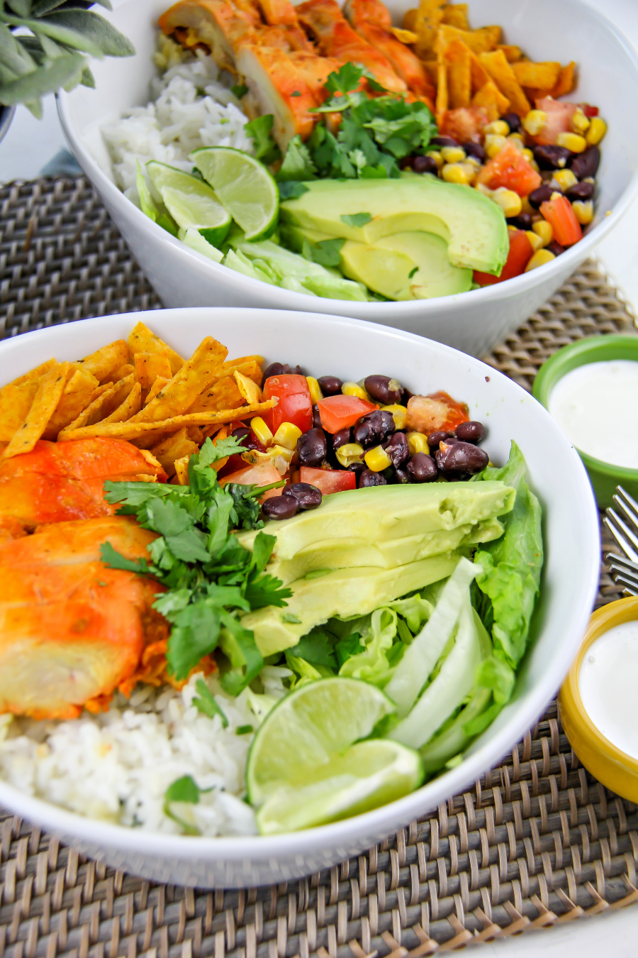 chicken taco ingredients with rice and avocado in bowls
