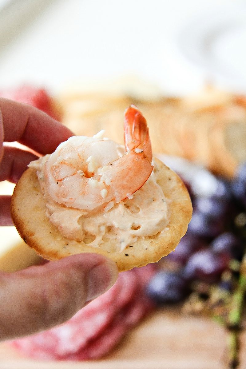 shrimp and cream cheese spread on a cracker
