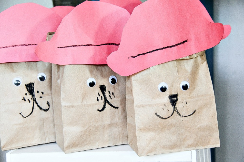brown paper bags that look like Paddington filled with popcorn