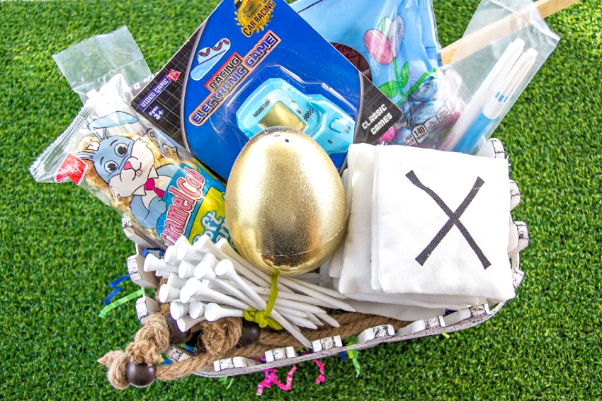 Easter basket filled with games, snacks, and golf tees for a teenage boy