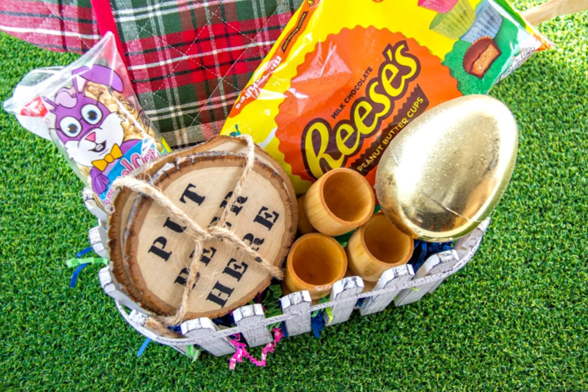 easter basket for college guys including beer coasters, kitchen items, treats, and money