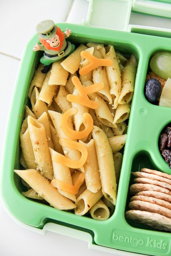 pasta with pesto in a green lunch box for kids