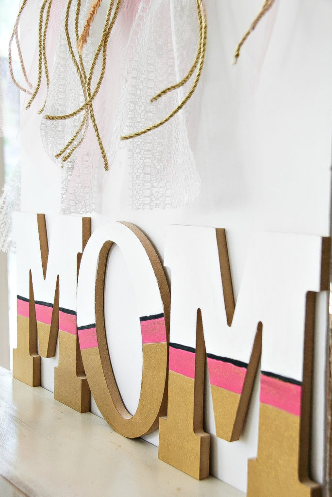 gold pink and white mom wood sign