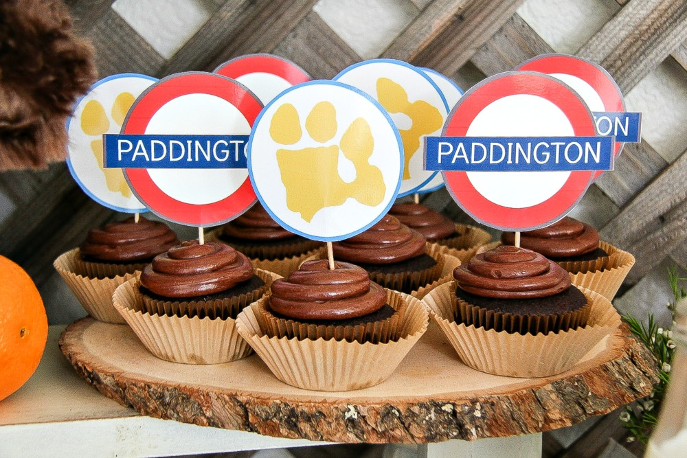 chocolate cupcakes with Paddington paper cupcake toppers