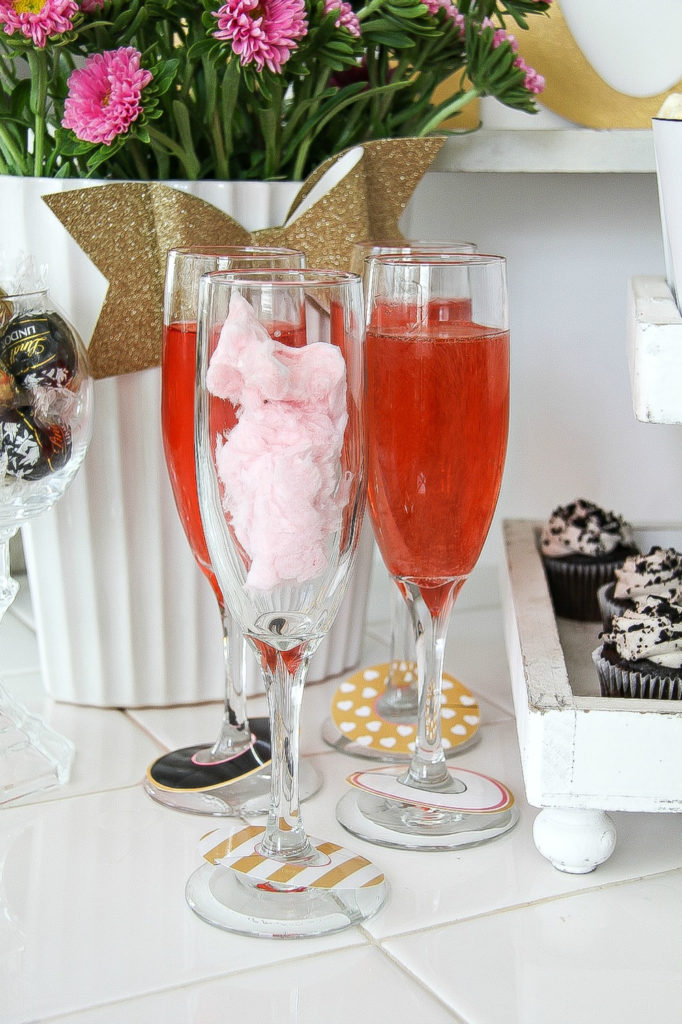 champagne glasses containing before and after of cotton candy and champagne