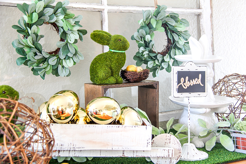 green and white farmhouse style easter decor on a table
