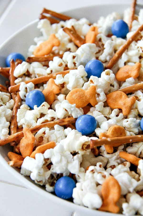 ocean themed snack mix with popcorn, goldfish, pretzel rods and blue candy