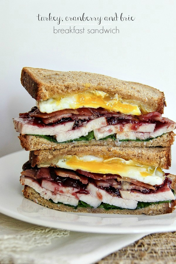 a breakfast sandwich with turkey, cranberry, egg, and brie
