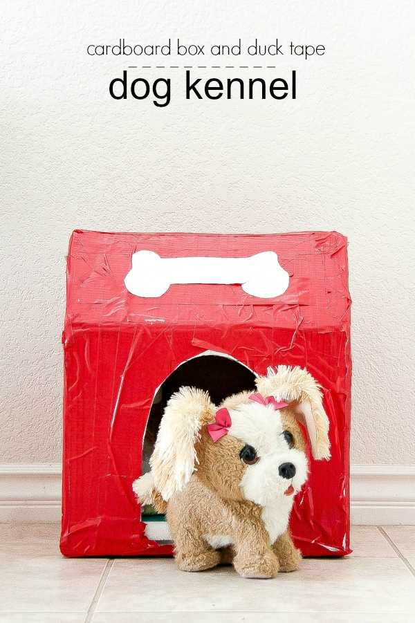 cardboard box and duck tape dog kennel in red and white with a toy dog sitting in it