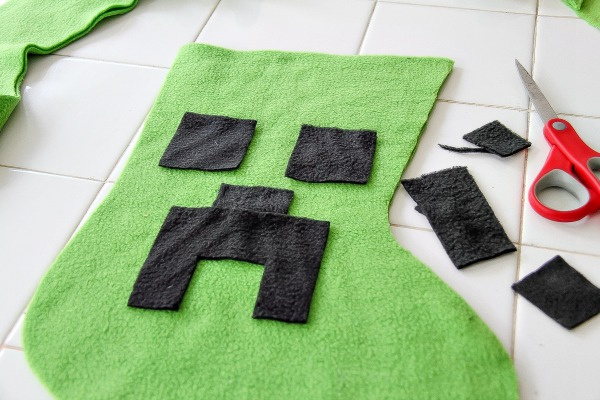 a minecraft creeper face cut out of black fleece