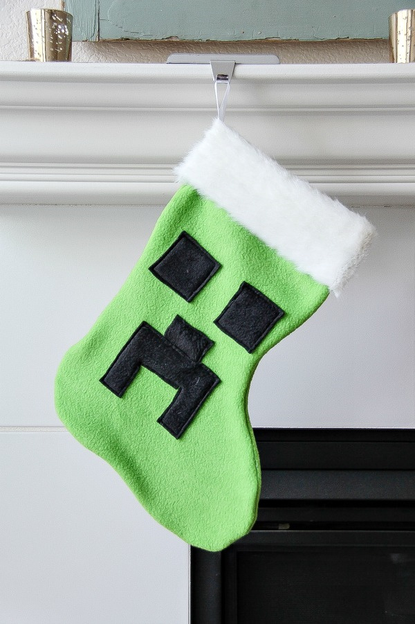 A Minecraft christmas stocking hanging from a mantel.