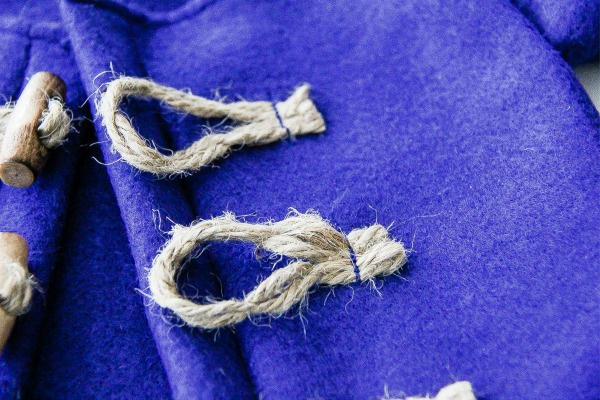 rope loops on a jacket for closing with toggles