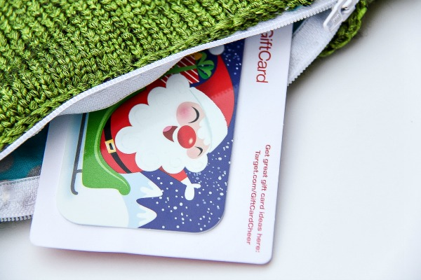 a Target gift card inside a green knit zippered pouch