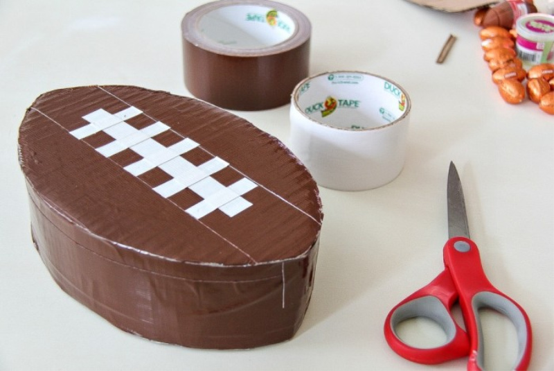 A football pinata made with brown tape