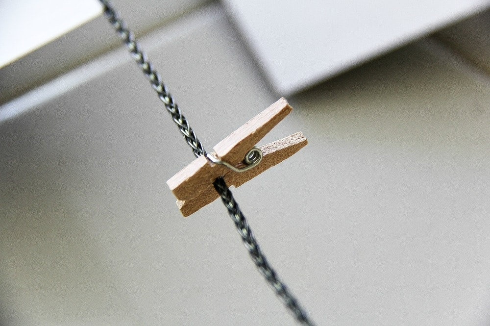 a small wood peg on a piece of wire for clipping photographs