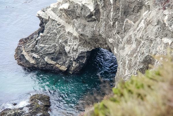 a rock bridge over the ocean