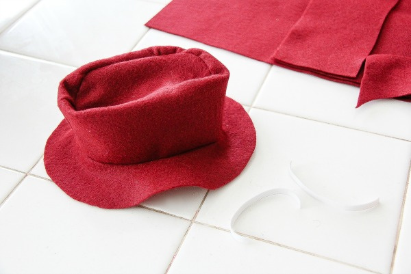 a red floppy hat made out of felt for a teddy bear