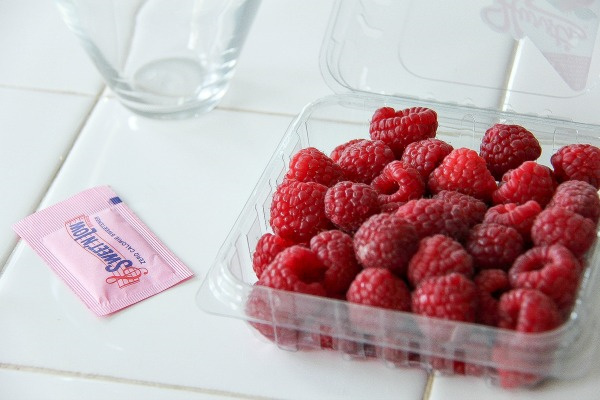 a punnet of raspberries and a packet of sweet 'n low