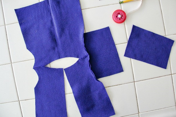 sewing steps for making a coat for a bear using blue felt