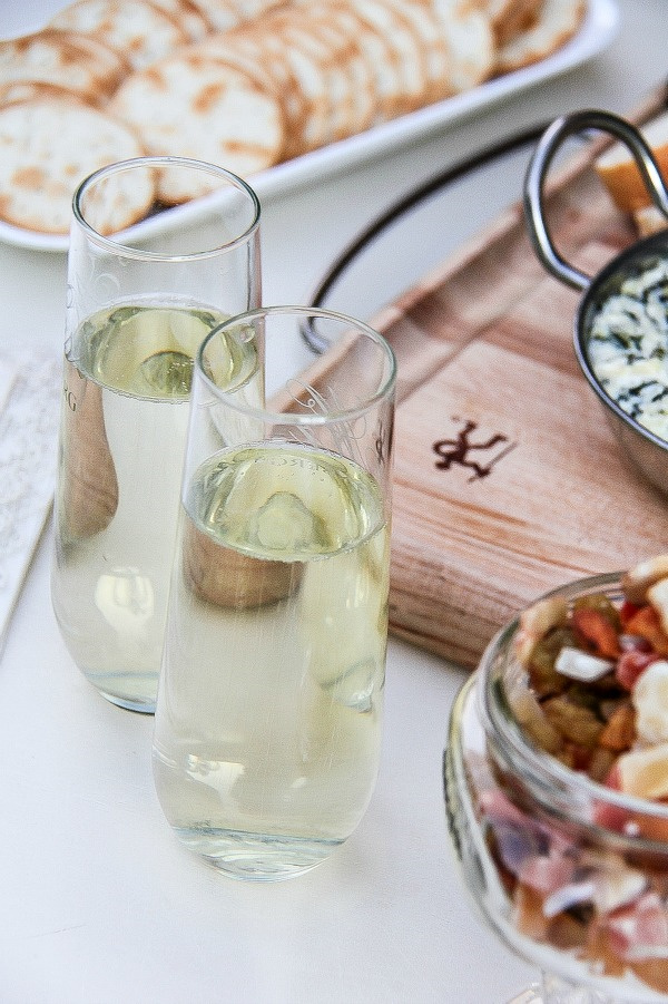 sparkling wine in champagne glasses with appetizers