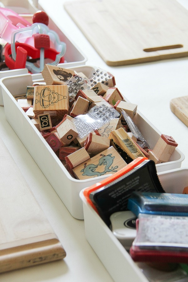stamps in a container for crafting