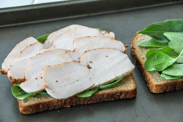 sliced turkey and spinach on whole wheat bread