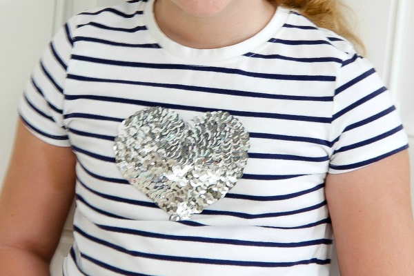 sequins in the shape of a heart on a striped tee