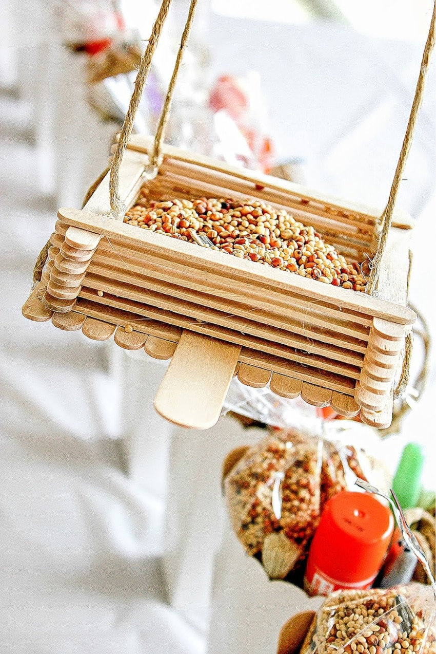 bird feeder made out of popsicle sticks