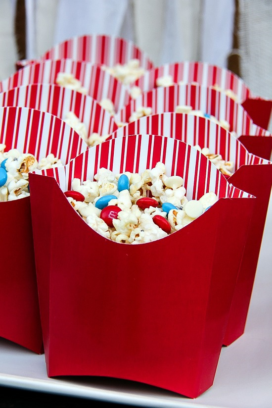 kettlecorn in red and white striped french fries tubs with red and blue M&M's inside