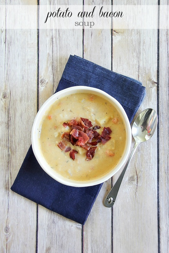 potato and bacon soup in a bowl on a blue napkin