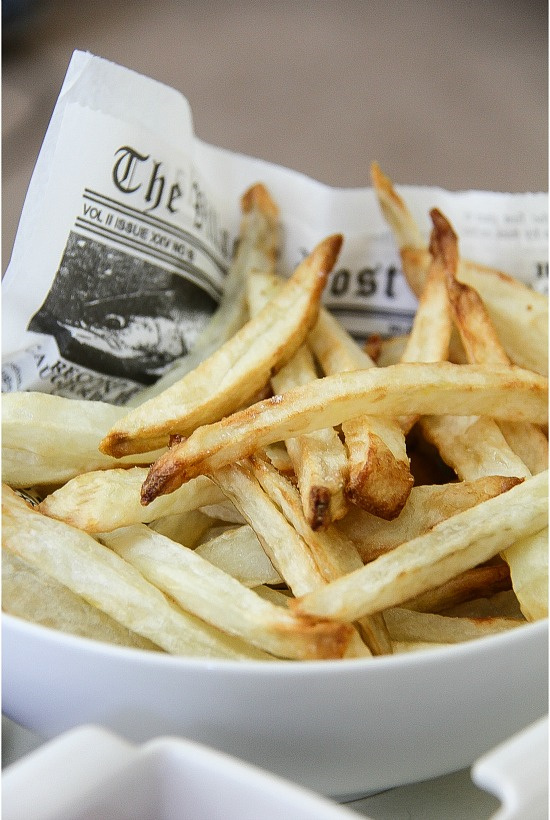 french fries on newspaper print made in the airfryer