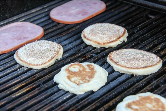 english muffins and ham steaks on the grill