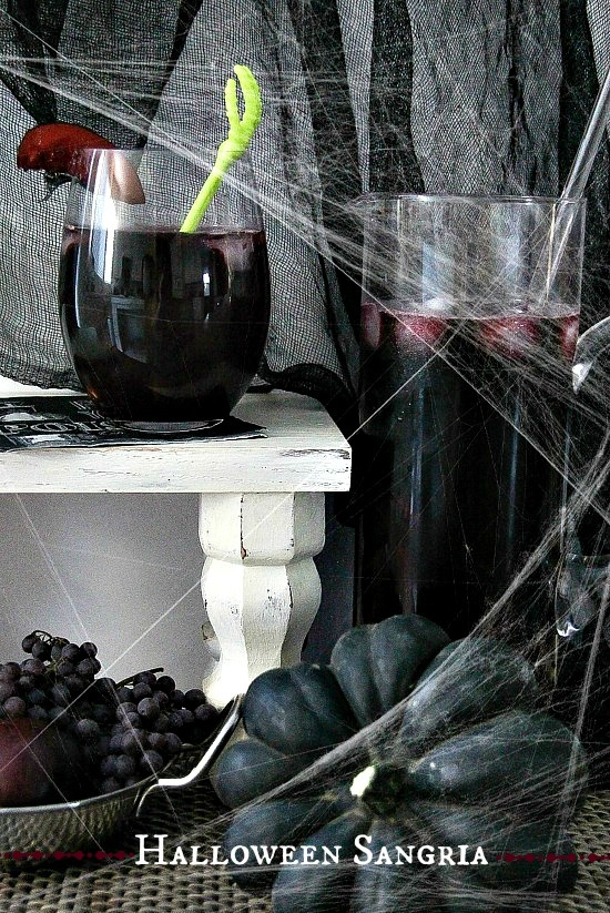 dark red wine halloween sangria with black grapes and peaches