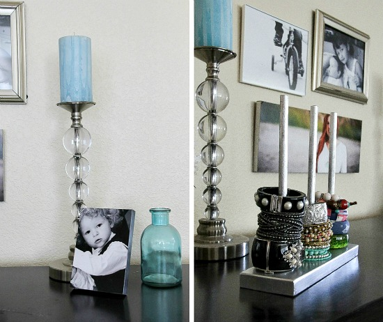 candlesticks, photo frames, and a jewelry organizer on top of a black cabinet