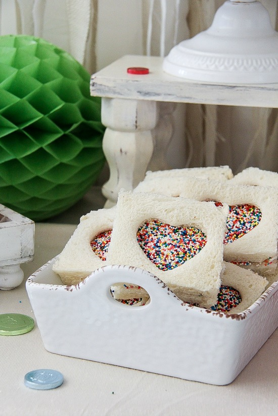 heart shaped fairy bread in a white container