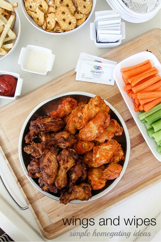 wings, carrot sticks, celery, and pretzels set out on a table