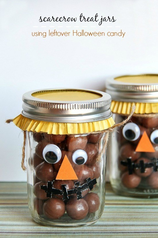 canning jars made to look like scarecrows with chocolate ball treats inside