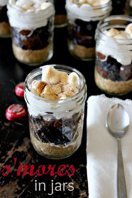 layered s'mores dessert in a jar made in the oven.